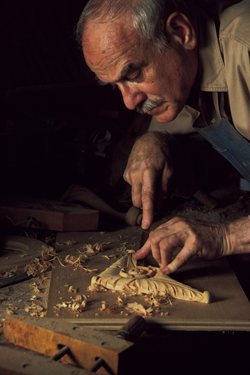 Woodworker creating an intricate design.