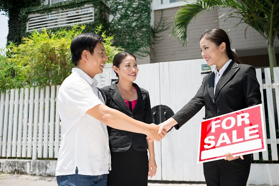 Real estate broker helping a couple buy a house