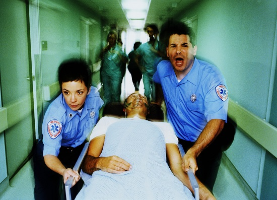 EMTs rushing a patient to the hospital