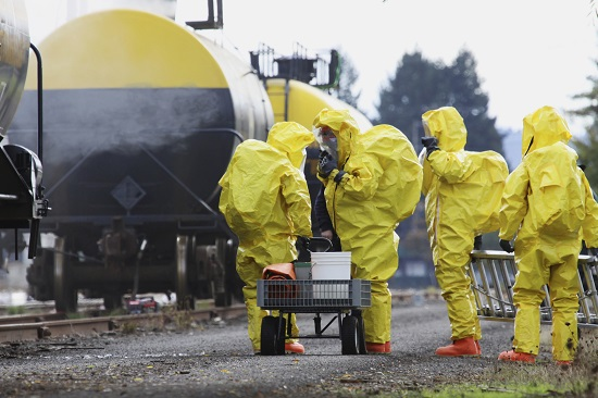 Hazardous materials removal workers in protective gear