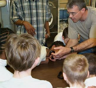 George Keeney shows a millipede to students.