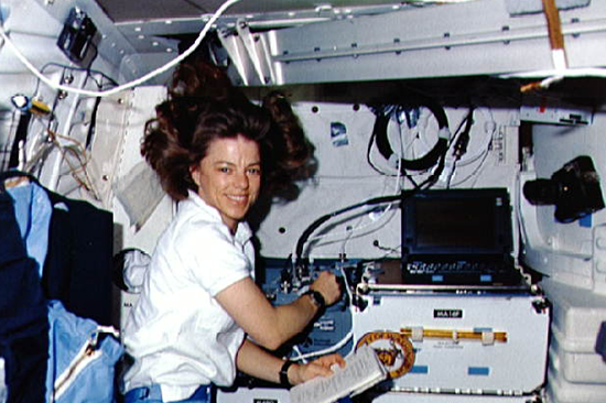 Bonnie Dunbar conducts experiments aboard a space shuttle. Photo courtesy of NASA.