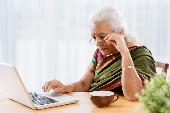 Older woman working on a computer