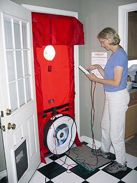 Energy auditor conducting blower-door test