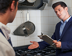 Health inspector conducting a kitchen inspection at a restaurant