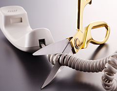 Image of phone cord being cut with a scissor.