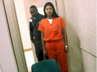 Inmate and correctional officer in jail cell