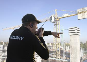 armed security guard pointing