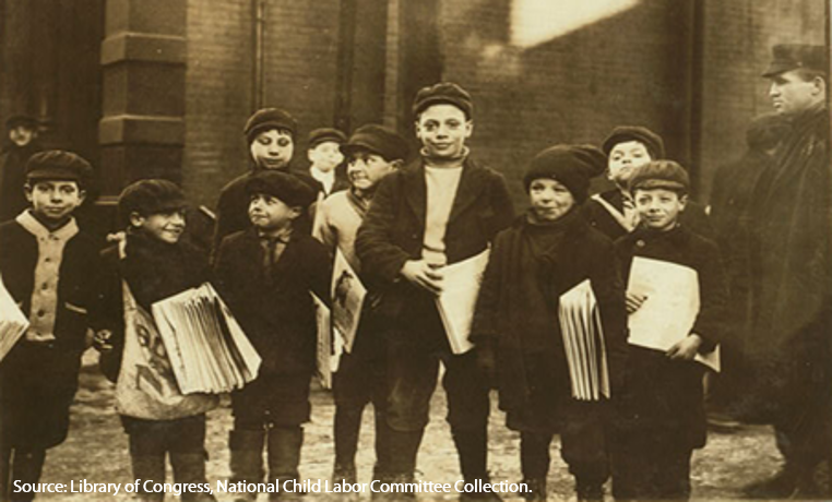 Young newsies (boys) at the newspaper office after school in Buffalo, New York, in 1910.