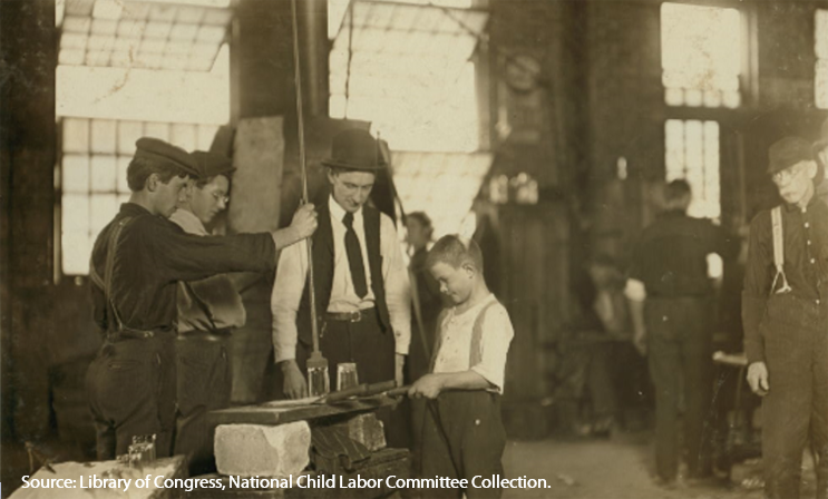 Glass factory employees teaching a young boy glass making, Morgantown, West Virginia, about 1908.