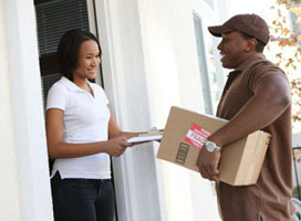 Working delivering package to residence