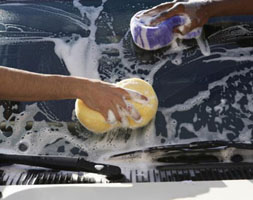 Person hand-washing car